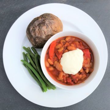 bean-goulash-jacket-potato-soured-cream-cheese