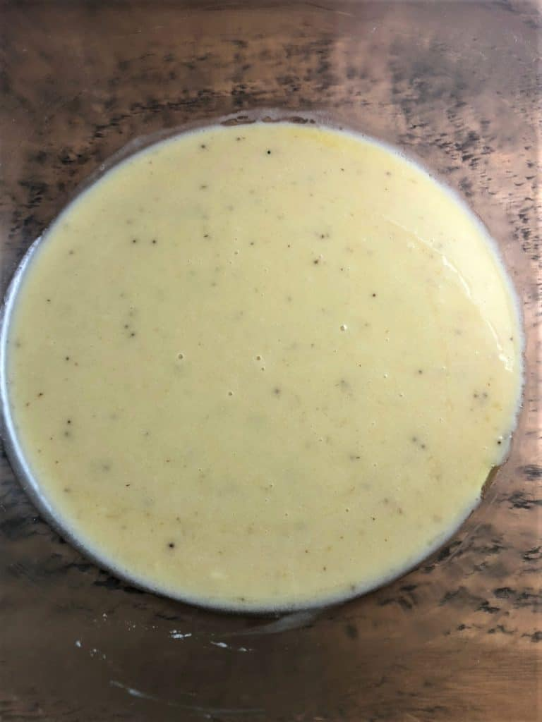 wet mixture of bananas egg and butter