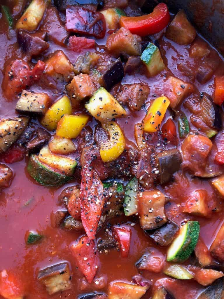 peppers onion courgette aubergine in passata in pan