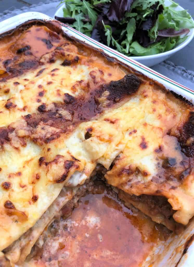 beef lasagne in dish portion removed