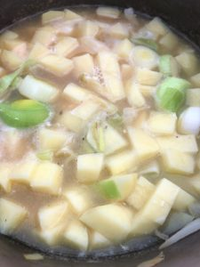 diced potatoes and leeks simmering in stock