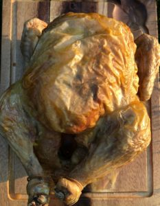 roasted chicken on a wooden board