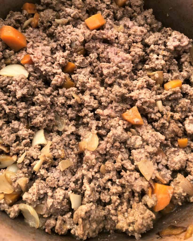 mince carrots and onions in pan