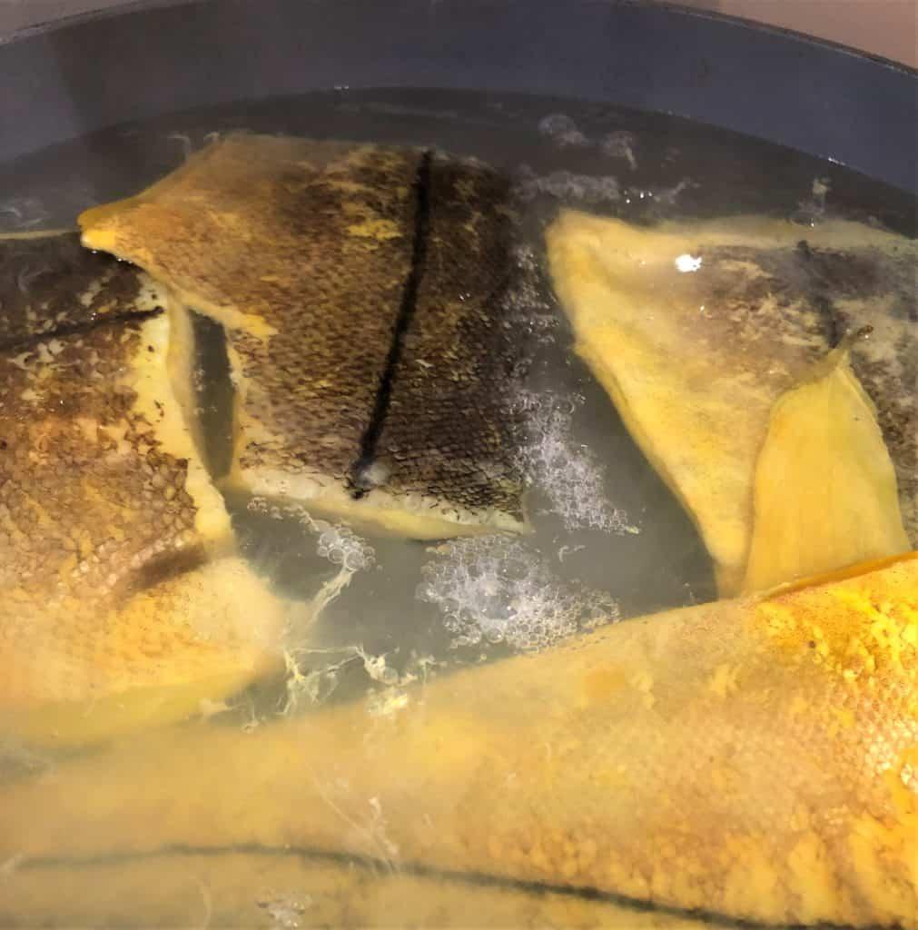 smoked haddock boiling in pan
