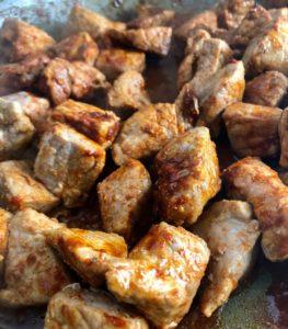 diced pork and papriak in pan