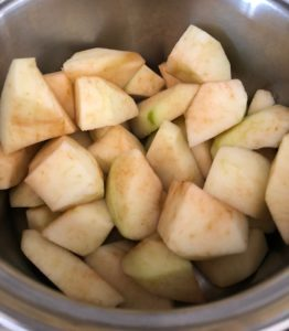 chopped cooking apples in pan