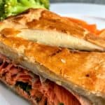 sliced salmon en croute slice with cream cheese and spinach