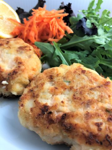 salmon fishcakes with green salad grated carrot
