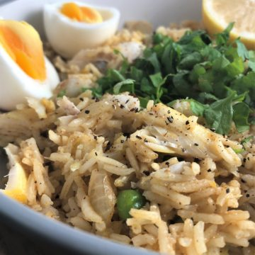Simple Kedgeree with Smoked Haddock egg and sliced lemon in bowl
