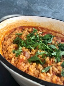 Tomato and Basil Risotto in dish fresh basil sprinkled on top