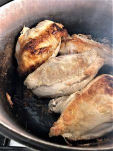 chicken pesto olives chicken breasts frying in pan
