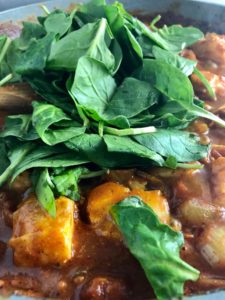 Easy fish curry in pan with spinach