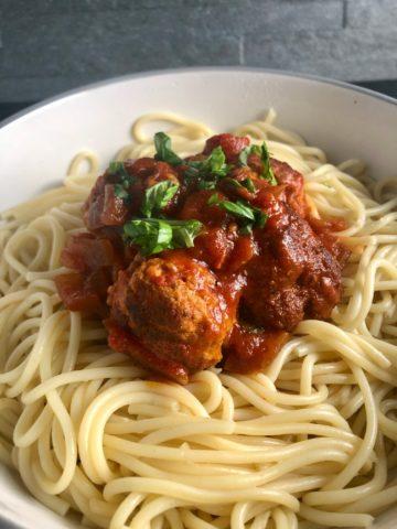 pork meatballs in a rich tomato sauce with spaghetti