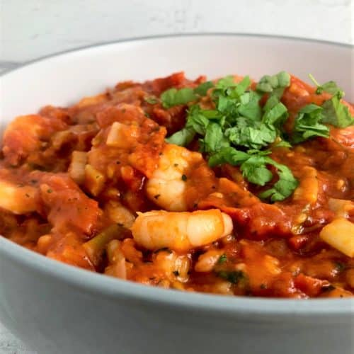 spicy prawns in tomato sauce with fresh parsley