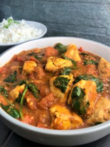 Easy Chicken Balti Curry Recipe in bowl with rice on side