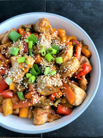 Sweet and sour pork with sesame seeds