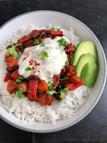 Vegetarian Chilli with sweet potato rice avocado in dish