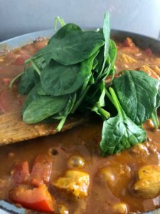 chicken balti spinach added to curry sauce