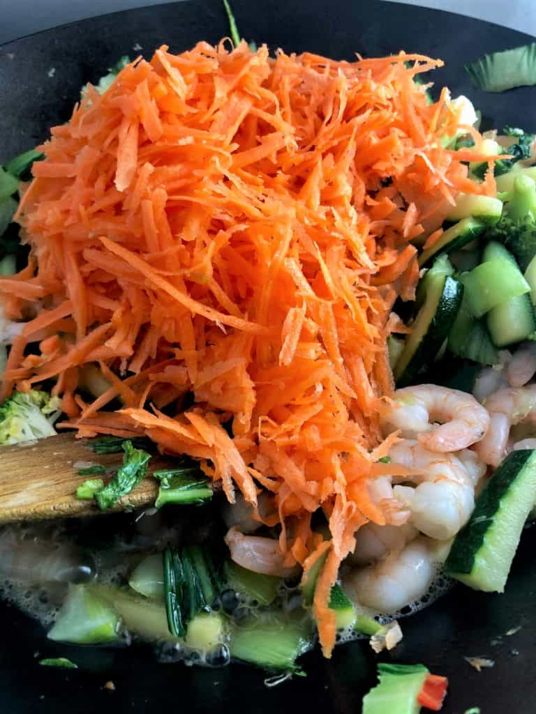 stir fry prawns broccoli courgette grated carrot added to pan