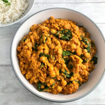 Chickpea Lentil and Spinach curry with rice in background