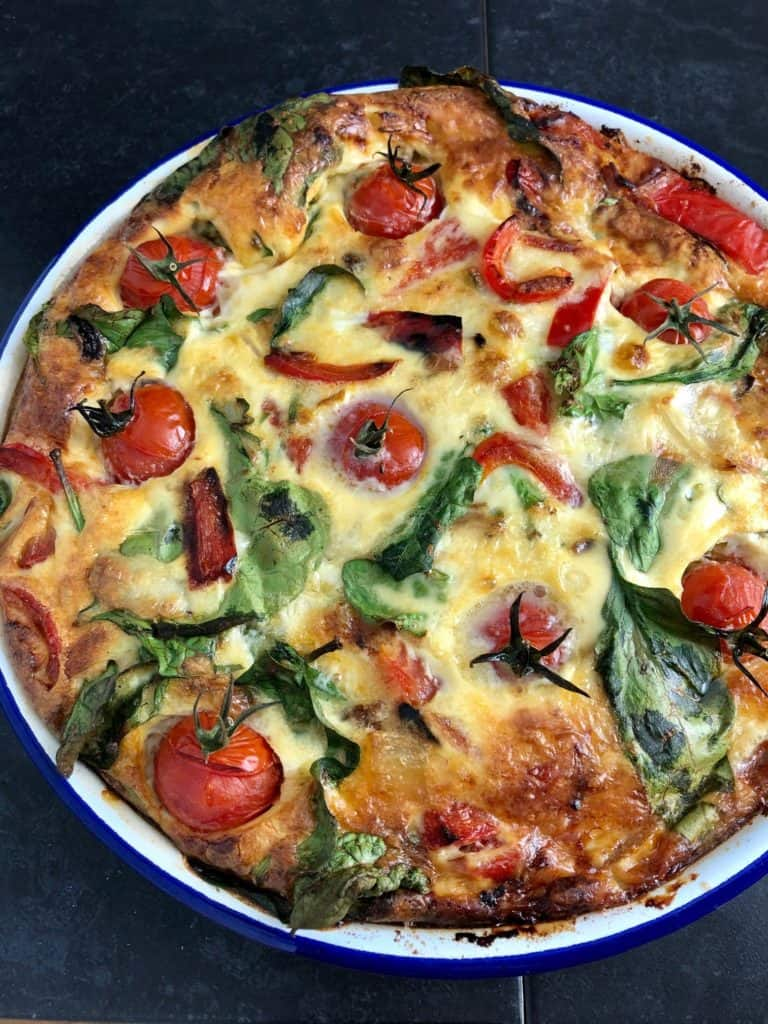 crustess quiche cooked with tomatoes spinach red pepper