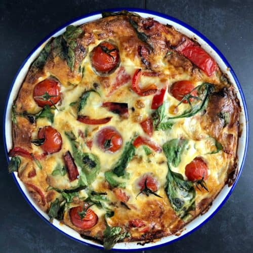 Crustless quiche cooked with tomatoes red pepper spinach