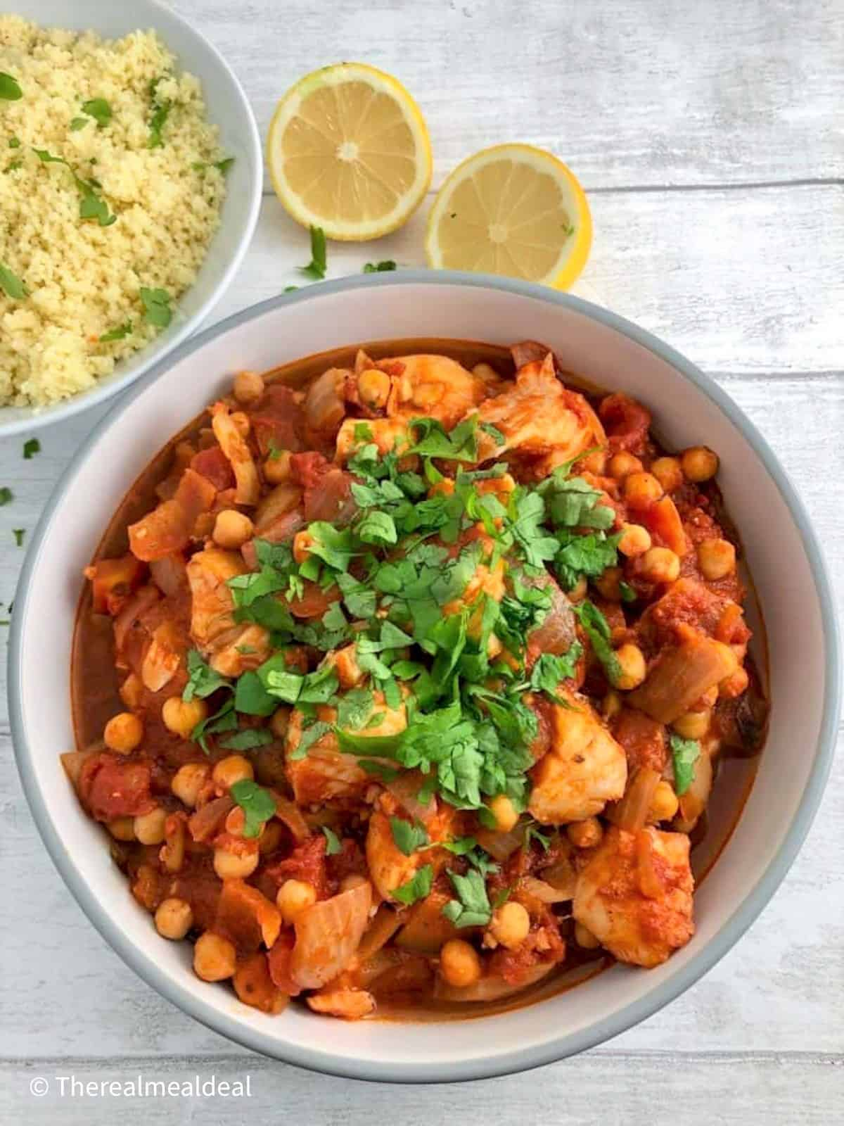 spanish fish stew with fresh parsley and a side of lemon coucous