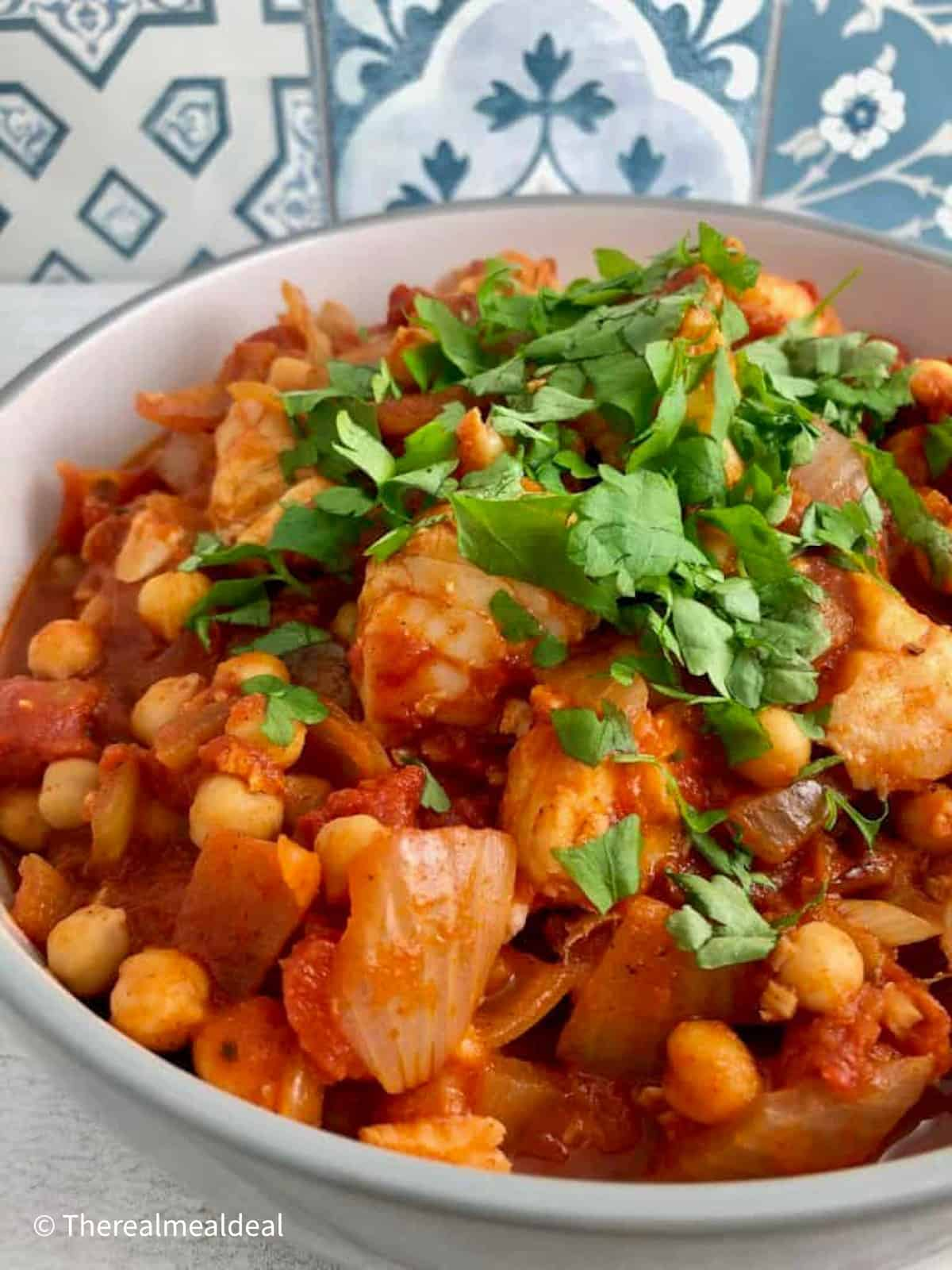 Fish and chickpea stew with sprinkling of fresh parsley