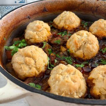 beef stew and dumplings in casserole pot