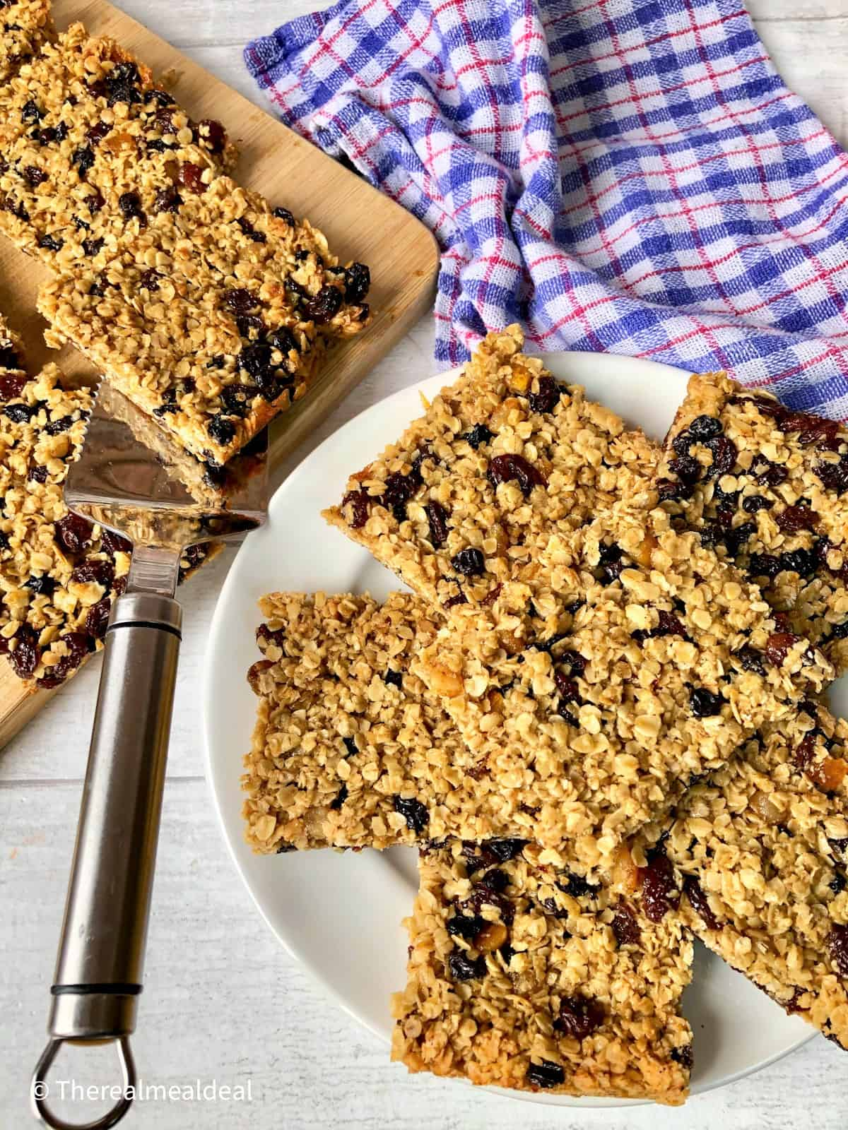 sliced chewy oat flapjacks on chopping board and plate