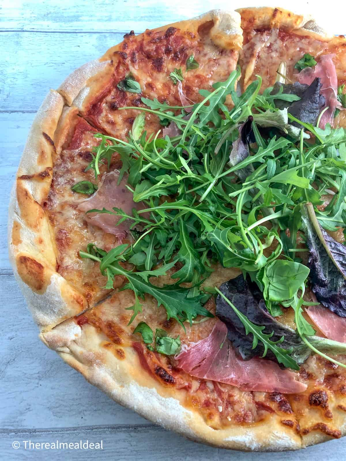 pizza with rocket and parma ham