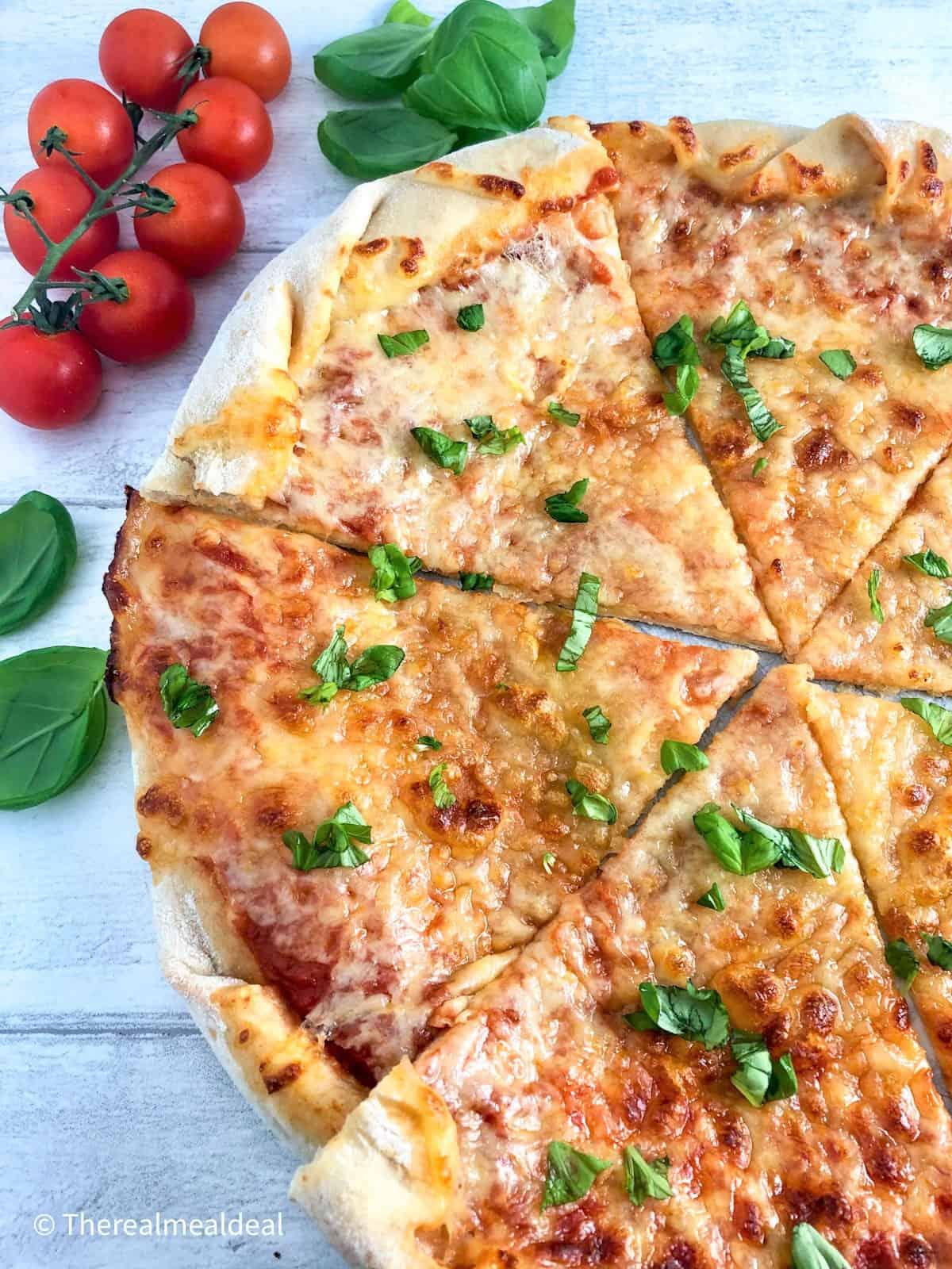 sliced homemade margarita pizza