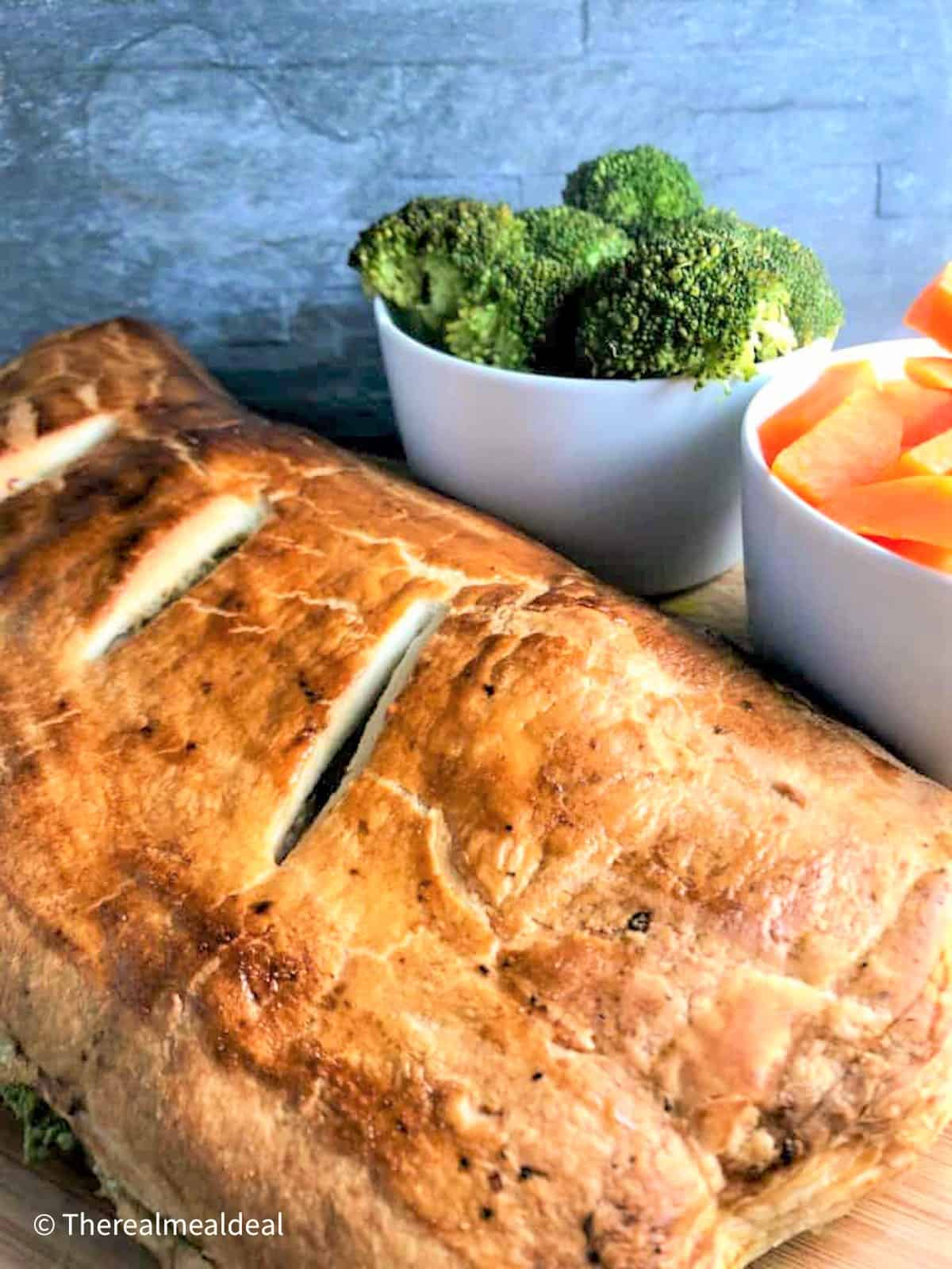 salmon en croute large parcel cooked with broccoli and carrots side dish
