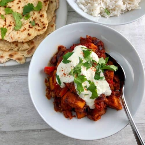 Sweet potato chilli with soured cream and flatbreads and rice