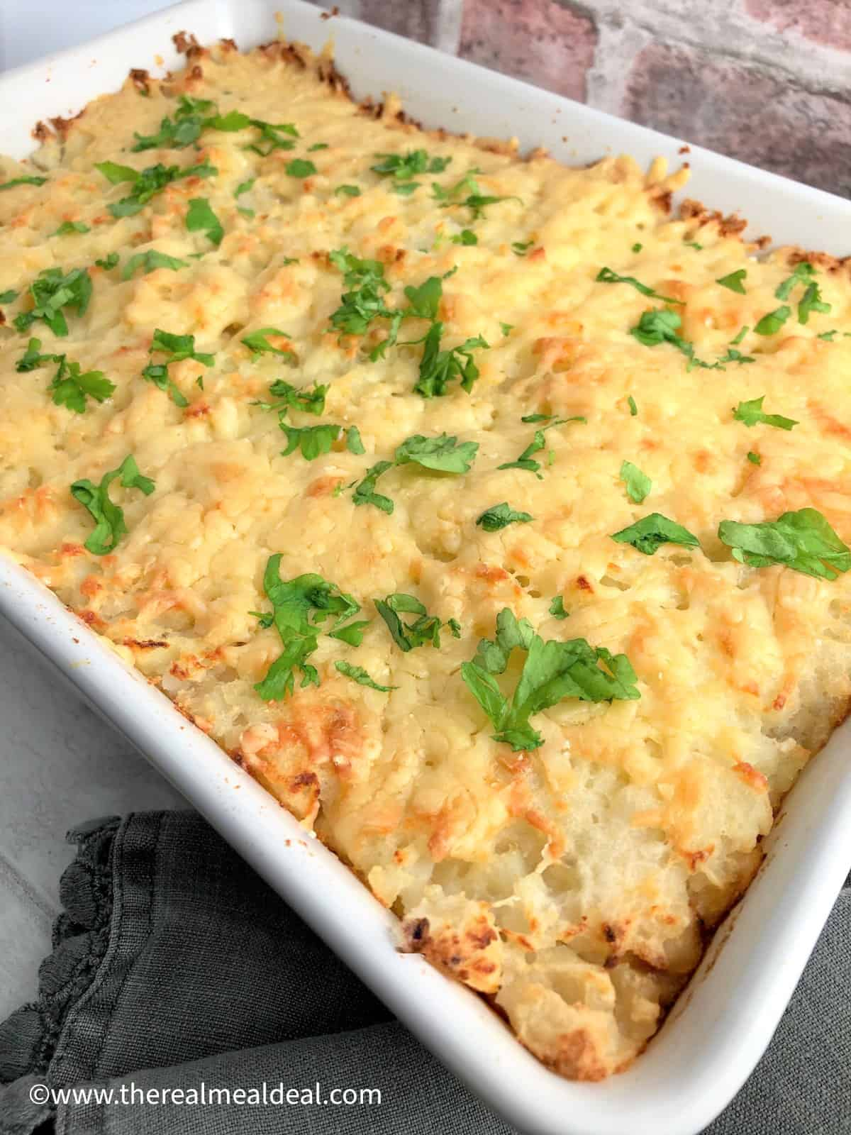 vegetarian cottage pie cooked in dish topped with fresh parsley leaves