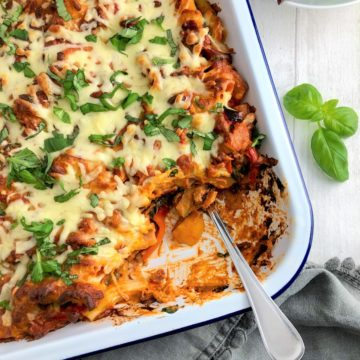 Vegetable Pasta bake in tray topped with fresh basil leaves