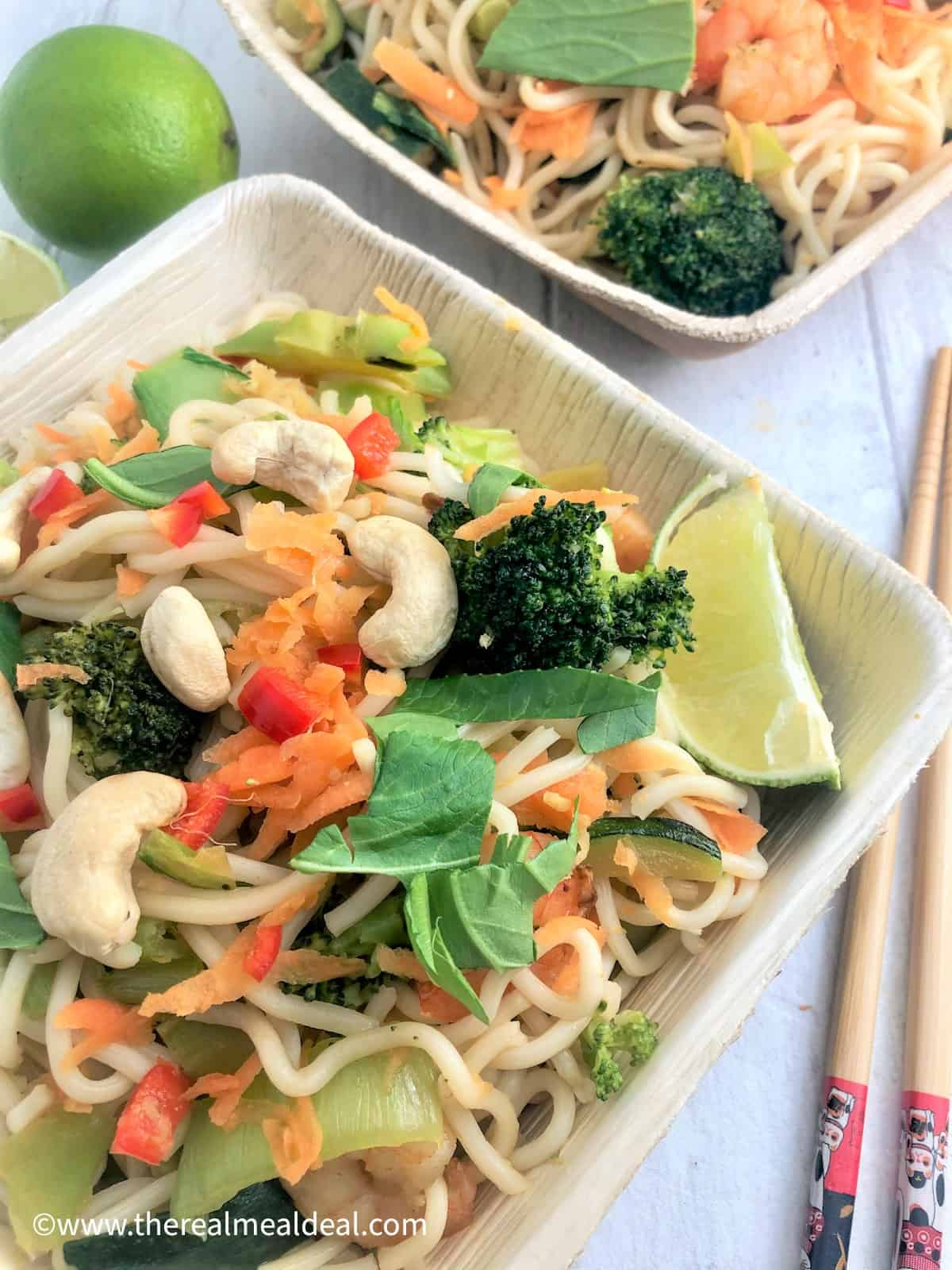 prawn stir fry with noodles in bamboo dish with chop sticks
