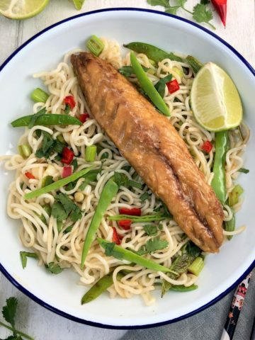 smoked mackerel salad with noodles mangetout spring onions red chilli chopsticks to side and fresh lime and red chilli