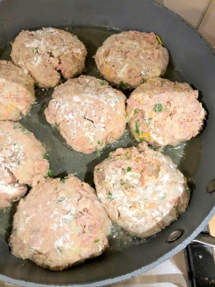 tuna fishcakes frying in pan