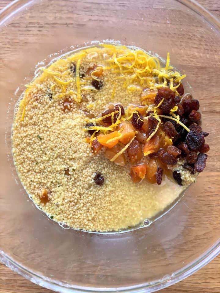 couscous stock dried apricots sultanas lemon zest soaking in bowl