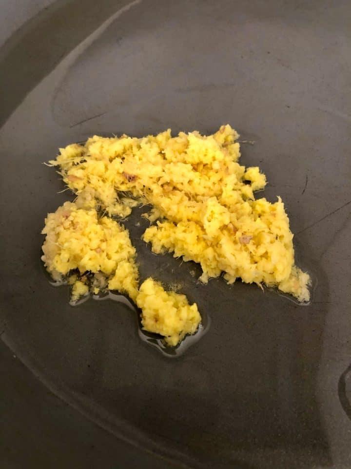 crushed garlic and ginger frying in pan