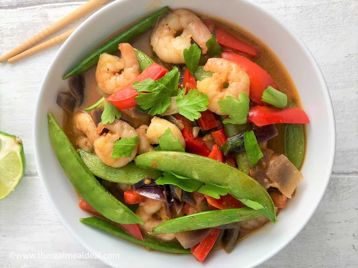 thai red prawn curry with vegetables in bowl