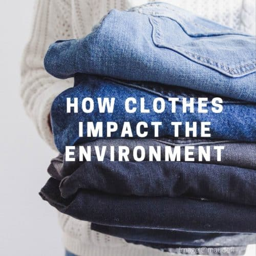 person holding stack folded jeans with text how clothes impact the environement overlaid on image